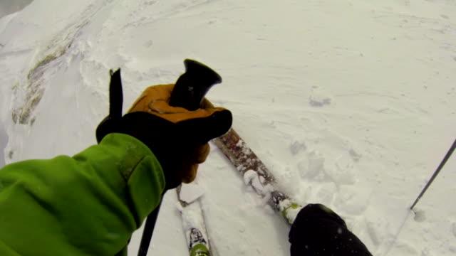 pov of a man downhill skiing. - wintermantel stock-videos und b-roll-filmmaterial