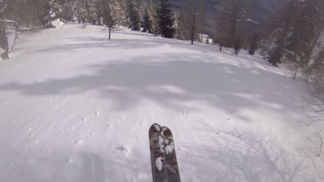 POV of a man downhill skiing.
