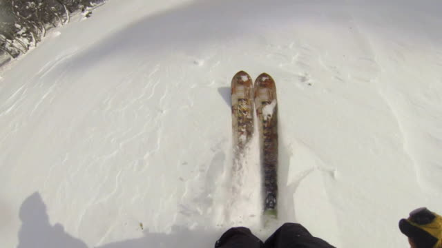 pov of a man downhill skiing. - downhill skiing stock videos & royalty-free footage