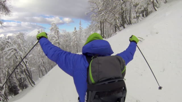 pov of a man downhill skiing. - arms outstretched stock videos and b-roll footage
