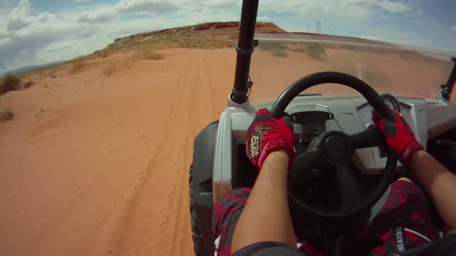 pov of a man driving a quad atv all-terrain vehicle off-road in arizona. - quadbike stock videos & royalty-free footage