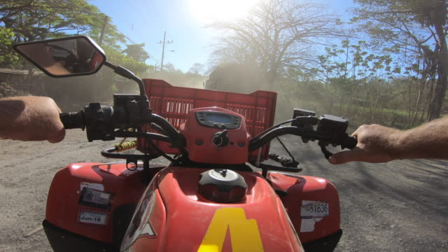 pov of a man driving an atv quad motorized vehicle passing a truck. - nosara stock videos and b-roll footage