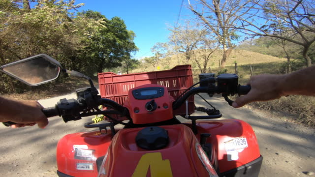 pov of a man driving an atv quad motorized vehicle. - time-lapse - nosara stock videos and b-roll footage