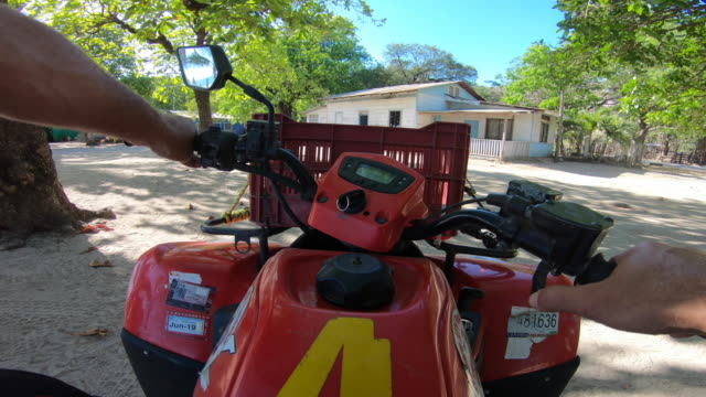 pov of a man driving an atv quad motorized vehicle. - nosara stock videos and b-roll footage