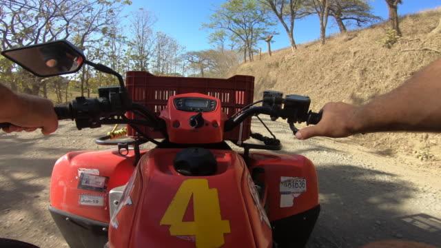 pov of a man driving an atv quad motorized vehicle. - quadbike stock videos & royalty-free footage