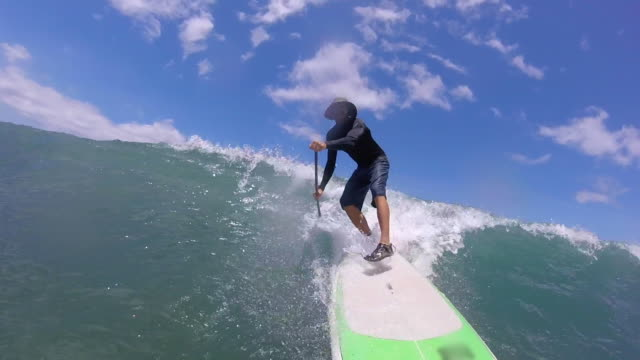 pov of a man falling while sup stand-up paddleboard surfing and a wipeout crash fall. - slow motion - wipeout stock videos & royalty-free footage