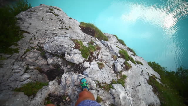 pov of a man hiking on a trail in the mountains near lake lago di sorapiss in italy. - lago stock videos & royalty-free footage