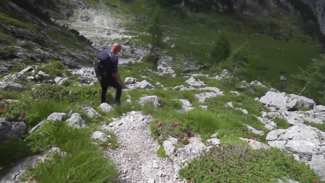pov of a man hiking on a trail in the mountains. - completely bald stock videos & royalty-free footage