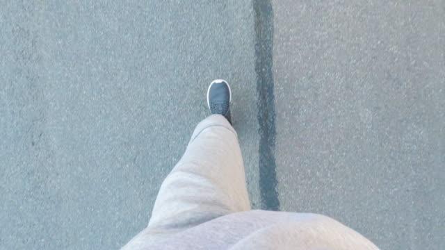 pov of a man jogging outdoors - sweatshirt stock videos & royalty-free footage