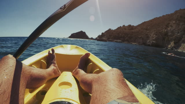 pov of a man kayaking in a summer sea - kayak video stock e b–roll