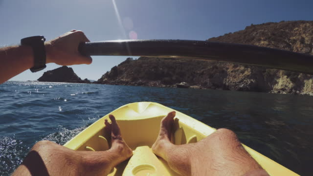 pov of a man kayaking in a summer sea - canoeing stock videos and b-roll footage