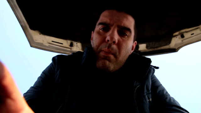 a man opens hood of car - tow truck stock videos and b-roll footage