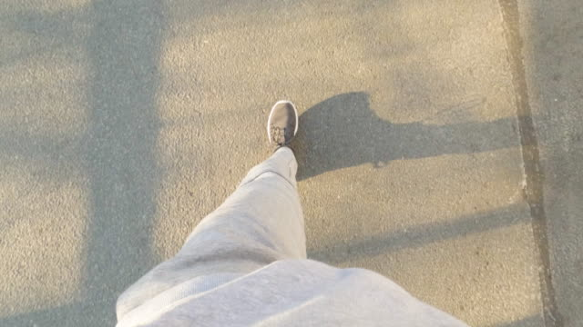pov of a man out on a walk - elevated view stock videos & royalty-free footage