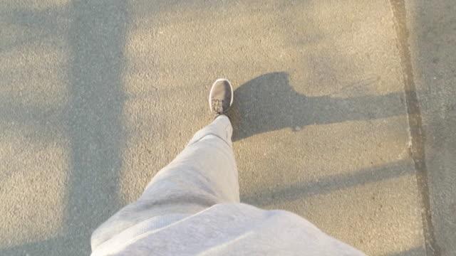 stockvideo's en b-roll-footage met pov van een man uit op een wandeling - elevated view
