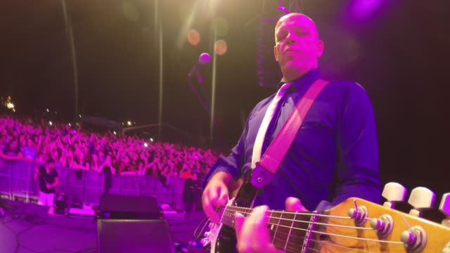 pov of a man playing an electric guitar in the evening concert - guitarist stock videos & royalty-free footage