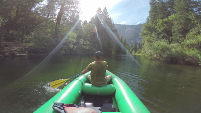 pov of a man rafting in merced river of yosemite - merced river stock videos & royalty-free footage