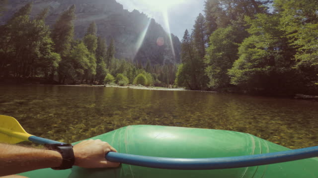 pov of a man rafting in merced river of yosemite - rafting stock videos and b-roll footage