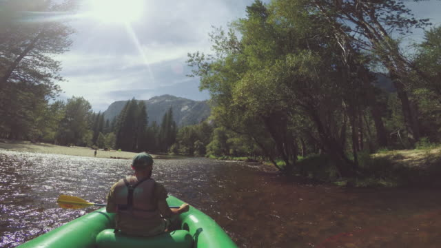 pov of a man rafting in merced river of yosemite - yosemite national park stock videos and b-roll footage