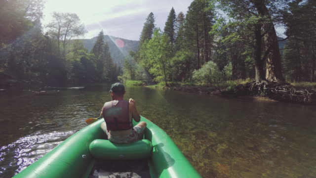 pov of a man rafting in merced river of yosemite - river merced stock videos & royalty-free footage