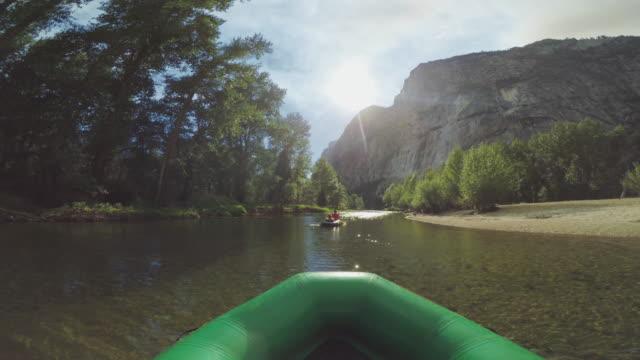pov of a man rafting in merced river of yosemite - canottaggio video stock e b–roll