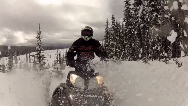 pov of a man riding on a snowmobile. - helm stock-videos und b-roll-filmmaterial