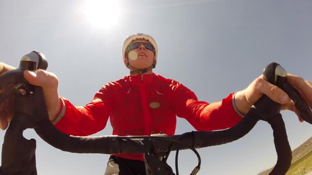 POV of a man road biking on a scenic road.