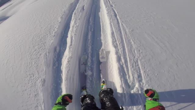 pov of a man skiing in the mountains in fresh powder snow. - slow motion - bastoncino da sci video stock e b–roll