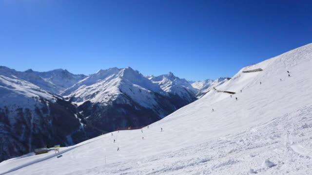 pov of a man skiing in the mountains in fresh powder snow. - time-lapse - ski pole stock videos & royalty-free footage