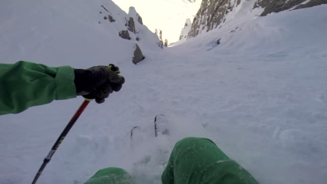 pov of a man skiing in the mountains in fresh powder snow. - ski holiday stock videos & royalty-free footage