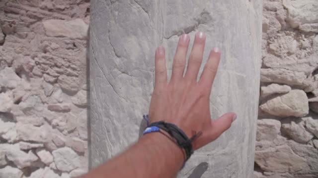 pov of a man tourist touching a stone column in greece. - males stock videos & royalty-free footage