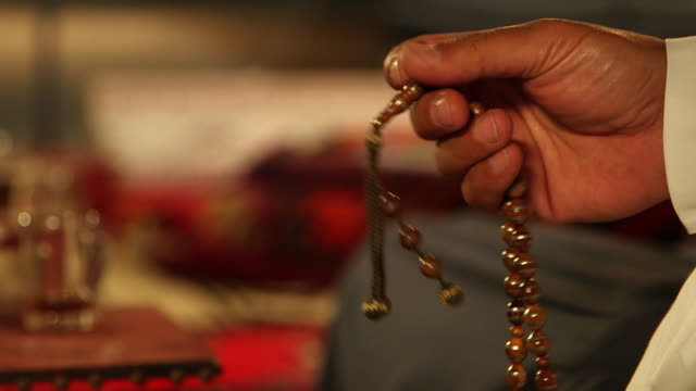 of a man's hand playing with a string of worry beads. - jiddah stock videos & royalty-free footage