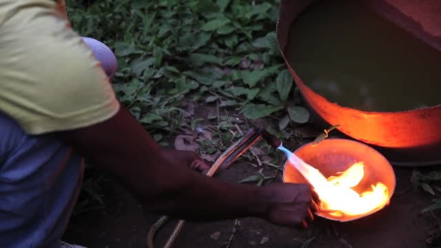 ECU a miner using a blowtorch to purify crude gold The region of Madre de Dios in SouthEastern Peru has been devastated by illegal gold mining it has...