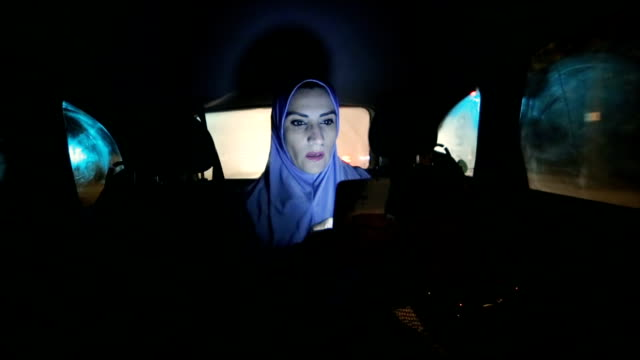 a modern arab woman rides in a car  at night - only women stock videos & royalty-free footage