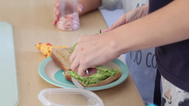 a mother and toddler making toast for breakfast. - toasted bread stock videos & royalty-free footage