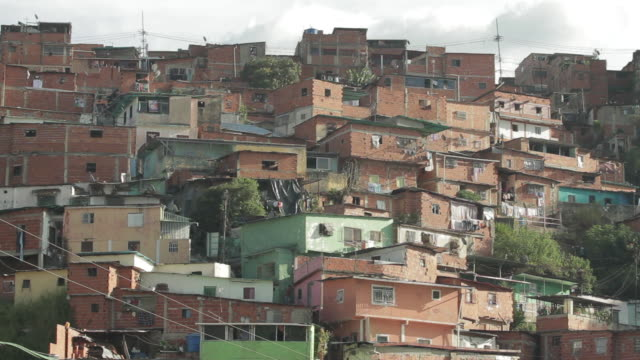 the shantytowns favelas very poor housing of venezeual 1 ws of a main street and houses 2 ms of people walking on the street 3 ms of houses 4 ms of... - latin america stock videos & royalty-free footage