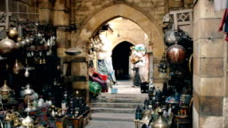 a porter carries goods at khan el khalili market