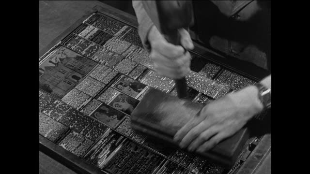 vídeos de stock e filmes b-roll de montage a printer sets linotype for a local newspaper / uk / executive smokes pipe and holds pen / man looks down and smokes / hands write notes / man writes notes and smokes - máquina de linótipo