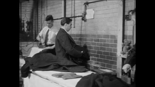 ts a prisoner discusses a present for his dad / uk / prisoners operate sewing machines / prisoner stands up / prisoner carries clothes to prisoner / prisoner examines stuffed toy animal / prisoner puts toy down and walks - prisoner education stock videos & royalty-free footage