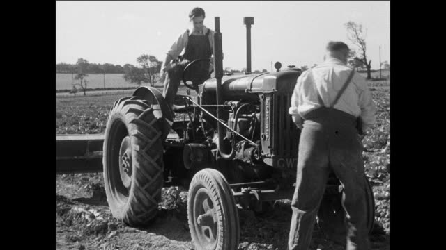 ts a prisoner drives a farm tractor in a field / uk / prisoner cranks tractor / prisoner gets behind tractor wheel / prisoner drives tractor down field / prisoner chases tractor - prisoner education stock videos & royalty-free footage