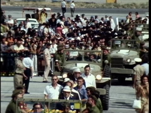 in a procession of military vehicles are carrying coffins of israeli olympic team members that were killed in the munich massacre followed by... - war or terrorism or military stock-videos und b-roll-filmmaterial