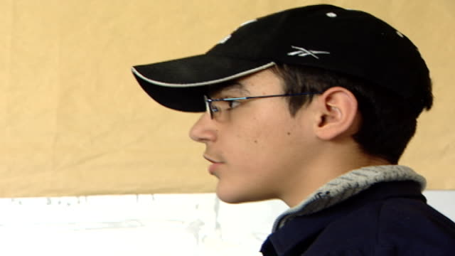 of a pupil's profile wearing a black baseball cap, answering a history question at irfan, a druze religious school which operates as an ngo. - theology stock videos & royalty-free footage