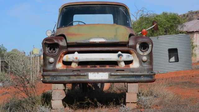 cu of a rusted car on stilts in southern australia - history stock videos & royalty-free footage
