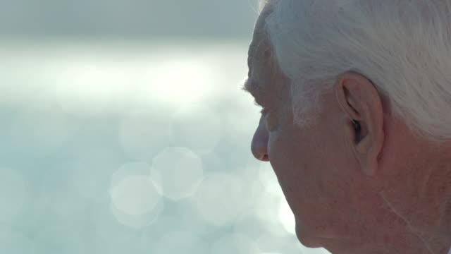 vídeos de stock, filmes e b-roll de cu of a senior man on the terrace by the sea. - homens idosos
