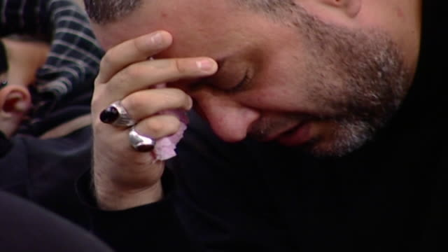 ecu of a shiite man crying during the ashura commemoration ashura is the 10th day of muharram in the islamic calendar commemorating the death of... - ashura muharram stock videos & royalty-free footage