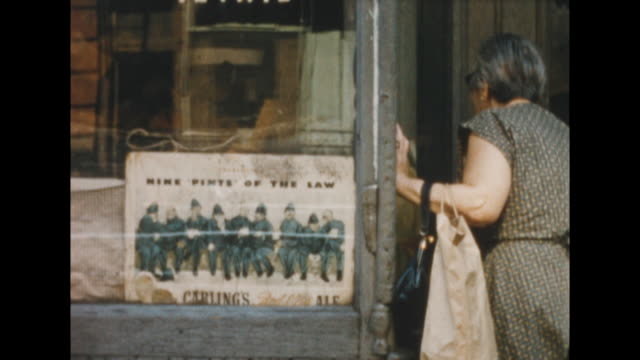 of a sign in a storefront in new york's lower east side for carling's red cap ale, 9 pints of the law. the storefront. a cat in store window... - judaism stock videos & royalty-free footage