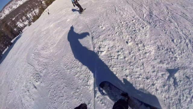 pov of a snowboarder snowboarding downhill at a ski resort. - mammoth lakes video stock e b–roll