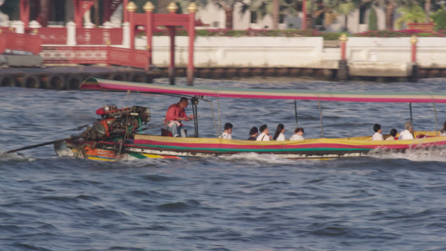 ls ts a socalled 'long tail boat' plying the chao phraya river, red r3d 4k - propeller video stock e b–roll