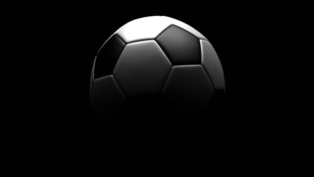 a soccerball rotating loop isolated with luma matte - palla sportiva video stock e b–roll