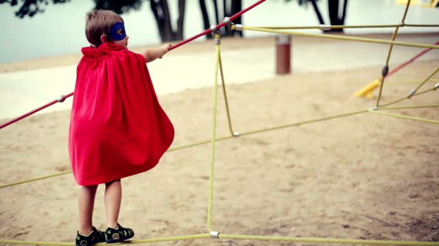 a superman on the playground