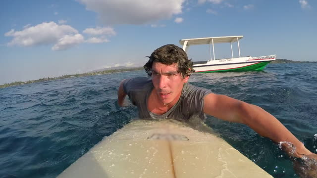 pov of a surfer jumping and diving of a water taxi boat with his surfboard. - water taxi stock videos & royalty-free footage